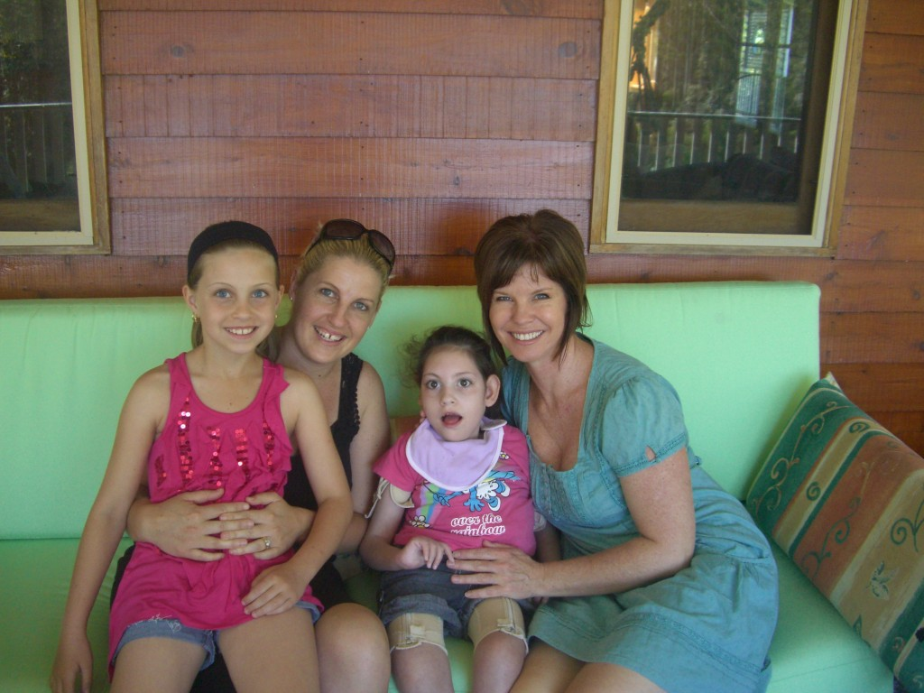Liat Harrower, Breanna Ward, Mickayla Ward, Shannan Ward at the QLD ofice of children's charity I Give A Buck Foundation
